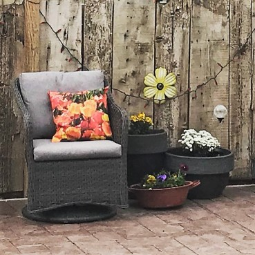 This is one of my cute pillows I made on Zillow with my own pictures. I love how it compliments my backyard decor.